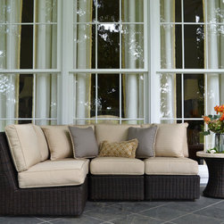 Outdoor Furniture - This outdoor sectional sofa comes in multiple finishes... the fabric comes in a variety of colors and patterns. Not real wooden wicker… The most durable outdoor wicker material on the market is used to make this product.  It is a High Density polyethylene wicker resin.  It is not hollow but completely filled so that allows more durability as well.