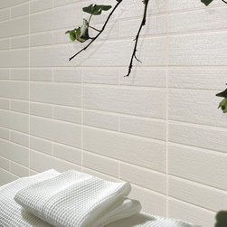 """Bathrooms - Bellavita's Creekside Glass in the color River Sand. Installed as mixed sizes of 3""""x12"""" and 2""""x6""""."""
