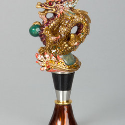 "Jay Strongwater - Dragon Wine Stopper with Stand - MULTI COLORS - Jay StrongwaterDragon Wine Stopper with StandDetailsMade of cast metal.Hand enameled and hand set with Swarovski crystals.2""W x 1""D x 4.75""T.Imported.Designer About Jay Strongwater:Jay Strongwater's love of the elegant but vividly bejeweled objet whether it's meant to rest on a tabletop or the graceful curve of a woman's neck has led him on a journey through the worlds of fashion and home furnishings. He began his career while a student at the Rhode Island School of Design. After garnering raves for a necklace he'd made his mother he took jewelry samples to open buyer days at some of New York's finest department stores and soon a burgeoning business was born. At the age of 23 Strongwater met designer Oscar de la Renta with whom he began to collaborate on jewelry designs for runway shows. The move to home accessories was delightfully serendipitous & organic. For the 1994 holiday season Strongwater sent gifts of jewel-encrusted filigree picture frames to friends fashion editors and buyers who immediately fell in love with the design. By 1998 his Jewels for the Home collection had supplanted his fashion business. In essence Strongwater created his own niche: the jeweler turning his meticulous eye and art toward a world beyond a woman's wrists neck and ears."