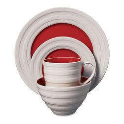 Midcentury Red Dinnerware Set - 16 pieces - This dinnerware set includes a dinner plate, dessert plate, bowl, and coffee mug for four guests. Each piece is made of stoneware and has a thickly ribbed exterior that contrasts with its brightly colored center.