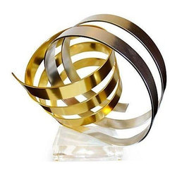 Used Intricate Dan Murphy Ribbon Sculpture - An intricate ribbon sculpture by Dan Murphy in silver and gold tones. Demonstrating dynamic movement, this piece can be viewed from all angles. It's supported by a square lucite base, and signed in the center and dated 1983.
