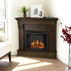 Real Flame - Chateau Corner Electric Fireplace in Dark Wal - 1400 Watt heater, rated over 4700 BTUs per hour. Programmable thermostat with display in Fahrenheit or Celsius. Ultra Bright LED technology with 5 brightness settings. Digital readout display with up to 9 hours timed shut off. Dynamic ember effect. Fireplace includes wooden mantel, firebox, screen, and remote control.. Solid wood and veneered MDF construction. 40.9 in. W x 25.3 in. D x 37.6 in. H (77 lbs.)The Chateau Corner Fireplace features the clean lines and classic styling familiar to stone mantels, realized in wood. In three great finishes, this design is sure to compliment a variety of decor, from the classic to contemporary. The Vivid Flame Electric Firebox plugs into any standard outlet for convenient set up. Thermostat, timer function, brightness settings and ultra bright Vivid Flame LED technology.