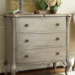 Helene Three Drawer Console - Such pleasingly graceful lines. The Helene Chest has three ample drawers framed with undulating curves on the top and down the legs, rounded ogee and sloping chamfered edges and antique verdigris brass hardware. Built of solid poplar veneers, it's hand-painted and distressed in taupe.