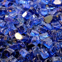 "American Fireglass Cobalt Blue Reflective | 1/2-in Fire Glass | 1 lb - AFF-COBLRF12 American Fireglass Cobalt Blue Reflective 1/2"" CRYSTAL BRILLANCE Fireplace Gems 1 lbPerfect for outdoor fire pits and fireplaces Provides unequaled versatility: available in a multitude of colors & sizes Glass Gems are tempered for long term heat exposure - Thanks to the special manufacturing process Fireglass Gems retain their color and actually burn cleaner than gas logsSold in 1 lb Bags1/2"" COBALT BLUE REFLECTIVE FIREGLASS is available in our 1/2"" Premium Collection. It is by far the brightest color we carry and looks fantastic in any application that utilizes stainless steel. Cobalt Blue looks amazing in any color fireplace and will add a fresh and vibrant atmosphere to any outdoor setting.An Average 36"" Fireplace Takes Approximately 60 lbs. of gemsAn Average 42"" Fireplace Takes Approximately 80 lbs. of gems Lava granules can be used initially on the burner then covered with Fireglass Gems to reduce the amount neededCombine multiple gem colors for spectacular fire!"