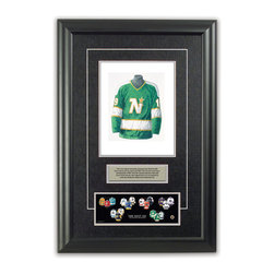 """Heritage Sports Art - Original art of the NHL 1968-69 Minnesota North Stars NHL Team jersey - This beautifully framed piece features an original piece of watercolor artwork glass-framed in an attractive two inch wide black resin frame with a double mat. The outer dimensions of the framed piece are approximately 17"""" wide x 24.5"""" high, although the exact size will vary according to the size of the original piece of art. At the core of the framed piece is the actual piece of original artwork as painted by the artist on textured 100% rag, water-marked watercolor paper. In many cases the original artwork has handwritten notes in pencil from the artist. Simply put, this is beautiful, one-of-a-kind artwork. The outer mat is a rich textured black acid-free mat with a decorative inset white v-groove, while the inner mat is a complimentary colored acid-free mat reflecting one of the team's primary colors. The image of this framed piece shows the mat color that we use (Silver). Beneath the artwork is a silver plate with black text describing the original artwork. The text for this piece will read: This is an original watercolor painting of the 1968-69 Minnesota North Stars jersey and was used in the NHL """"Next Six"""" print below and thousands of NHL """"Next Six"""" products that have been sold across North America. This original piece of art was painted by artist Tino Paolini for Maple Leaf Productions Ltd. Beneath the silver plate is a 3"""" x 9"""" reproduction of a well known, best-selling print that celebrates the history of """"The Next Six"""" 1967 expansion teams. The print beautifully illustrates the chronological evolution of each team's uniform and shows you how the original art was used in the creation of this print. If you look closely, you will see that the print features the actual artwork being offered for sale. The piece is framed with an extremely high quality framing glass. We have used this glass style for many years with excellent results. We package every piece very carefully"""