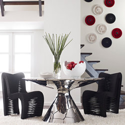 Photoshoot Fall 2012 - Stainless dining table accompanied by our Seatbelt chairs is a show stopper!  Coordinating wall decor as well.
