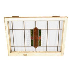Antiques - Antique English Lead Glazed Stained Glass Window - This is a beautiful antique English lead glazed stained glass window. It has a traditional wooden frame and it features a beautiful *astragal lead glazed textured stained glass window with a distinguished design.  It may show minor age appropriate signs of wear including wood imperfectionsbut as shown it is overall in very good cosmetic and structural condition.What is astragal (wood or lead) glazing?  As it pertains to later period furniture, it is a method of securing glass to the straight, semi-circular, or shaped moldings found on glass doors and windows of furniture. On newer reproduction furniture, the astragal molding may set atop the glass to give the appearance of glazing where on older English furniture, it is not uncommon for each piece of glass to be cut to shape and glazed into the molding.Other Dimensions (In inches)Glass 16.25H x 25WFrame 1.75W