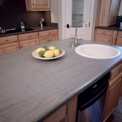 Corian® Natural Gray center kitchen island. - Photo by Dupont