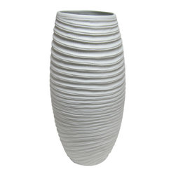Bahari - Porcelain Coco Vase Detail - Our matte finish, milky-white porcelain Coco Vase has a cylindrical shape and ribbed design that adds an organic sensibility to any floral arrangement or grouping of objects. Using traditional kiln-fired techniques that have been employed since porcelain originated each piece is hand-turned and crafted, thus every piece has its own character.
