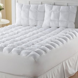 Wellrest Magic Loft Mattress Pad - Just like magic, the Wellrest Magic Loft Mattress Pad adds ultimate comfort while protecting your mattress. Comfort comes from its soft polyester fiber fill, quilted squares, and 200-thread count, 100% cotton construction. Its bed skirt, generous 18-inch pocket depth, and machine-washable nature adds convenience. This mattress pad comes in your choice of size.Mattress Pad Dimensions:Twin: 38x75 in.Full: 54x75 in.Queen: 60x80 in.King: 78x80 in.