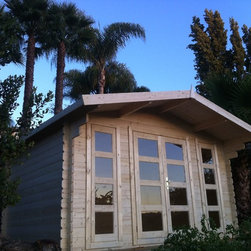 Summer 13 x 10 Wood Shed / Pool House - ECO Garden Sheds. All natural wood 13 x 10 traditional pool house/ wood garden shed -- Summer. Front side; in Garden.