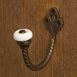 Small Twisted Rope Brass Hook with Ceramic Knob - With a twisted rope detail and ceramic knob, this hook will blend perfectly with a variety of decors. Add one or two to your entryways, bathrooms or even your kitchen to create easy storage for clothes, coats, pot racks and more!