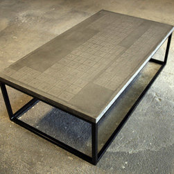 DeWulf - Periodic Coffee Table - Gather your friends around the unique, majestic, bold, industrial, and utterly sophisticated Periodic Coffee Table designed by DeWulf and eliminate once and for all, those arguments about the true atomic number of Selenium. This sophisticated coffee table is made from natural, luxurious, rich and sturdy concrete. Since it is poured, mixed, and hand-finished, the variations, warm look and soft tones, and smooth, buttery feel of the cocktail table are unique to the concrete. Built on steel legs with smooth, clean lines, the bold coffee tables periodic table design is actually entirely indented onto the concrete top. The indentation is so slight however, through a special process, that the design does not interfere with the flatness of the surface.