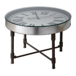 None - Cassem Aluminum Clock Table - Riveted,vintage aluminum clock frame is upturned onto a weathered,industrial metal base in rusted patina with gear details. Subtle dents and ripples reflect its hand-hammered construction. Motorized clock encased beneath clear glass uses one AA battery.