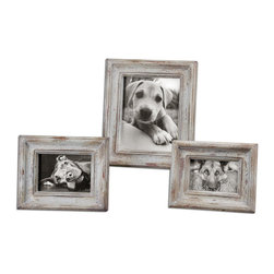 Uttermost - Niho Ivory Photo Frames Set of 3 - Heavily distressed aged ivory finish with natural wood undertones. Holds Photo Sizes:4x6, 5x7 & 8x10. Sizes:Sm-8x10, Med-9x11, Lg-12x14