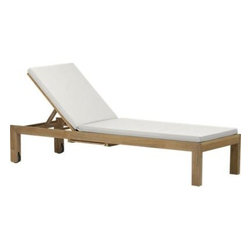 Regatta Chaise Lounge with Sunbrella® White Sand Cushion - Our eco-friendly Regatta teak lounge collection cuts a clean, classic profile in a bold wide-slat design. Relax in a generous four-position chaise lounge with convenient back wheels and the innovation of two pullout trays concealed beneath. Each piece is handcrafted of solid teak certified by the Forest Stewardship Council (FSC), a nonprofit organization that encourages responsible management of the world's forests. We recommend allowing the unfinished teak to weather to a silvery grey. To maintain the natural color, use our Golden Care® Teak Protector. Cushion is fade- and mildew-resistant Sunbrella acrylic in warm white sand. Regatta dining collection also available.