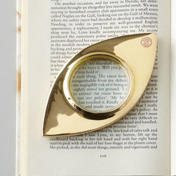 "Jonathan Adler 'Eye' Magnifying Glass - I love this brass ""eye"" magnifying glass because it is the perfect example of practical decor. My favorite pieces are those that look beautiful and are useful."