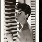Amanti Art - Audrey Hepburn Blinds Framed Print - This stunning, black & white photograph of Audrey Hepburn captures the rare charm of the award-winning actress, model and humanitarian.