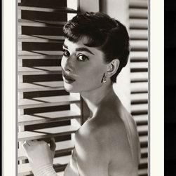 Amanti Art - Audrey Hepburn Blinds Framed Print - This stunning, black & white photograph of Audrey Hepburn captures the rare charm of the award-winning actress, model and humanitarian.