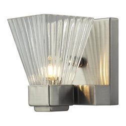 One Light Brushed Nickel Clear Ribbed Glass Bathroom Sconce - This spectacular single light wall sconce consists of a clear ribbed shade and is shown with a brushed nickel frame. This light, certain to stun its viewers, is also available with a chrome finish as well.