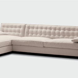 Giorgetti - Giorgetti Royal Sectional Sofa - Sectional sofa with totally removable covers with rectangular or square armrests, padded or in natural polished or dark painted Italian walnut.  The internal structure of the seat and of the backrest is in solid beech wood.  The cushion filling and the backrest are in feather with the inset in multi-density, non-deformable polyurethane foam.  The backrest cushion has a capitonnè effect with the innovative plus of having completely removable covers.  The structure of the padded, rectangular and square armrests is in multilayer poplar wood with the padding in non-deformable polyurethane foam, covered in fiber.  The cushions are in feather.  The rectangular armrest, padded or in Italian walnut, can only be used hooked onto the seat, whereas the square armrest, can be used as a stool when padded and as a small table when in Italian walnut.  A plinth must be added to bring it to the same level as the seat.  The wooden, rectangular and square armrest is veneered and the edges are in solid, natural polished or dark painted Italian walnut.  Price includes shipping to the USA.  Manufactured by Giorgetti.Designed in 2007.