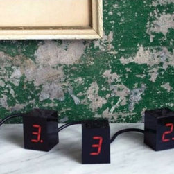 """Areaware - Numbers LED Alarm Clock - The Numbers LED Alarm Clock adds an innovative dimension to the standard alarm clock by giving the user control over the time's configuration. It consists of a chain of four individual cubes that each display one glowing LED digit. The numbers can be arranged to show the correct time horizontally, vertically, or any way you want. With the Numbers LED Alarm Clock you can wake up in style, or just rearrange the time if you want to justify a few more minutes in bed. Designed by: Jonas Damon Features: -Made of ABS and RoHS compliant electronics. -Clock comprised of a chain of four cubes. -Cubes can be arranged as desired. -Digital LED time display . Dimensions: -Each Cube: 1.5"""" H x 1.5"""" W x 1.5"""" D. Instructions: -Please view the LED Clock Instructions for information on how to use your Numbers LED Alarm Clock. Order with Confidence: -Should you discover shortly after receiving your Numbers LED Alarm Clock that parts are either damaged or missing, please call us immediately, and we will be happy to send you replacement parts as soon as possible and at no additional cost.."""