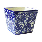Square Planter, La Paloma - Come home to a festive patio where bright flowers pour out of this elegant blue and white planter. Its classic floral motif adds a dose of polished charm to your outdoor space. With a drainage hole and square shape perfect for holding your favorite plant, your garden will flourish in cheerful contemporary style.