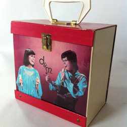 "Mid Century Modern Furniture & Accessories - The Donnie and Marie Osmond 45 record holder case is from the 1960's-70's when the two had their variety show. This case is in perfect condition. The top right front has a slight imperfection on the top where the image has split. That split measures about 1"" wide. The case measures 8"" wide X 5"" long X 7 1/2"" tall."