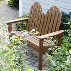 POLYWOOD - POLYWOOD Recycled Plastic Classic Adirondack Bench - ADBN-1GY - Shop for Benches from Hayneedle.com! The Recycled Plastic Adirondack Bench will make a beautiful addition to any the garden front yard or patio. With room for two this is truly a great place for you and someone special to sit down relax and enjoy the outdoors. Crafted from a resilient recycled-plastic material called POLYWOOD this bench is attractive comfortable and virtually maintenance-free. This all-weather bench is available in several attractive color options. Some minor assembly is required. Place your order today and enjoy this bench for a lifetime. About POLYWOODThe advantages of POLYWOOD Recycled Plastic are hard to ignore. POLYWOOD absorbs no moisture and will NOT rot warp crack splinter or support bacterial growth. POLYWOOD is also compounded with permanent UV-stabilized colors which eliminate the need for painting staining waterproofing stripping and resurfacing. This material is impervious to many substances including salt water gasoline paint stains and mineral spirits. In addition every POLYWOOD product comes with stainless steel hardware. POLYWOOD is extremely easy to clean and maintain. Simple soap and water is all you need to get rid of dirt and make your furniture look new again. For extreme cleaning needs you can use a 1/3 bleach and water solution. Most POLYWOOD furnishings are available in a variety of classic colors which allow you to choose your favorite or coordinate with the furniture you already have. This is sure to be a piece that you will be proud to own for a lifetime.