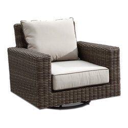 Thos. Baker - Outdoor Wicker Motion Club Chair | Hampton Collection - Oversized seating in all-weather wicker with a slightly weathered look inspired by classic whitewashed country home styles. Premium, dyed-through resin wicker with an extra large diameter profile and elegant ocean gray finish. Powder-coated aluminum subframe and brushed aluminum feet.Plush Sunbrella cushion sets included where applicable. Choose quick ship in khaki with cocoa piping, stone green or choose from our made-to-order fabric options.Made-to-order cushion sales are final and ship in 2-3 weeks.
