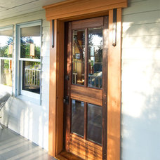Contemporary Front Doors by Real Carriage Door Company