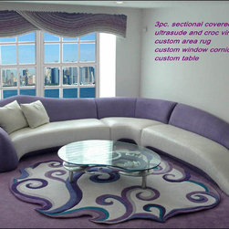 Custom living room nyc - A spectacular sectional combines leather seats with a dramatic lavender microsuede. The design of the turning arm is a classic, as is the sloping seats. The custom area rug is a hand drawn design that fits the shaping of the sectional and coordinates the colors in the room. All of our rugs are signed by Pia guaranteeing authenticity.
