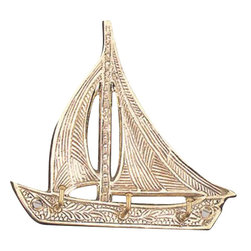 "Brass Sailboat Key Hanger - The brass sailboat key hanger is available in size 6"". It is made of sand cast, solid, polished brass and made to last. It will add a definite nautical touch to wherever it is placed and is a must have for those who appreciate high quality nautical decor. It makes a great gift, impressive decoration and will be admired by all those who love the sea."
