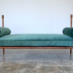 Keaton - The dripping forms of Gaudi inspired the elegant lines of the Keaton.  This unique hand crafted piece is both architecturally intriguing and comfortable.  We custom tailored every detail-from a cushion that is deep enough to recline, to a frame that hugs the custom bolsters.
