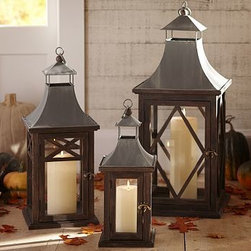 """Kingston Wood & Metal Lantern, Large - With sloped rooftops, charming door latches and ball finials, our handcrafted Kingston Lanterns light up nighttime gatherings beautifully. Small: 7"""" square, 18"""" high Medium: 9.5"""" square, 24"""" high Large: 12.5"""" square, 29.75"""" high Made of pine wood. Tin sheet metal with a gray finish. Glass panes. For both indoor and outdoor use."""