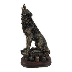 Antiqued Bronze Finish Howling Wolf Statue - This statue of a howling wolf stands 10 1/2 inches tall, is 5 1/2 inches wide and 4 inches deep. Made of cold cast resin, it has a metallic bronzed finish, rubbed with black paint, to give it the look of old metal. It makes a great gift for wildlife lovers.