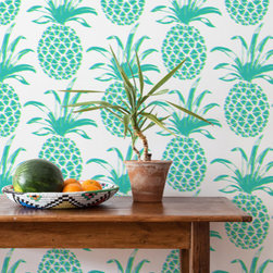 Piña Wallpaper - Wallpaper is so fun these days. Case in point, you can find the trendy pineapple in this mod print in seven different colors to decorate your walls — I love it in green and purple. Thank you, designer Aimee Wilder for this gem.