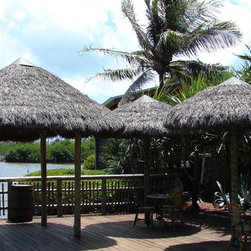 Natural Thatch - Tahiti Thatch Panels are often used for projects where one needs a rustic type thatch. Because it is so thick and full, these thatch panels are great for umbrlla canopies , concession stands or animal exhibit shelters.