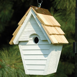 Wren in the Wind Bird House - This graceful hanging birdhouse is constructed of nature friendly cypress heartwood and will make a lovely home for any small Wren. It features copper trimming, excellent drainage, ventilation, rear panel cleanout and a convenient eyehook for easy hanging.
