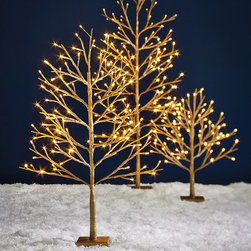 Frontgate - Luminous Tree - Christmas Decorations - For outdoor or indoor use. High-density polyurethane foam is molded to provide a natural feel and make each branch light and pliable. Includes pad to set tree on to prevent scratching surfaces. Timer function enables daily 6-hour run time. Pliable, durable branches can be shaped to desired position and then reshaped for easy storage. Our cordless Luminous Trees radiate in gold or silver, with long-lasting LEDs illuminating your pathway or indoor decor. Lifelike, pliable branches bear all-weather electrostatic paint and UV coating; they can be shaped if you're hanging ornaments. On/off and timer functions. 2 ft. Tree takes three AA batteries, 3 ft. Tree takes six, 4 ft. Tree takes nine; batteries not included. In Gold with Classic White LEDs and Silver with Pure White LEDs.  .  .  .  .  . 2 ft. Tree takes three AA batteries (not included) . 3 ft. Tree takes six AA batteries (not included) . 4 ft. Tree takes nine AA batteries (not included) . Battery boxes are waterproof .