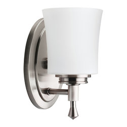 Kichler 1-Light Bath Fixture - Brushed Nickel - One Light Bath Fixture Not quite contemporary, not fully traditional - this one light bath fixture envelops Edith Wharton's principles of design. Intriguing concepts of basic shapes complement a brushed nickel finish and satin-etched cased opal glass. 100-w. Max. Width 5, height 9-1/2, extension 6. Fixture may be installed with glass up or down. Height from center of wall opening with glass up is 5. Backplate size: 7-1/2 x 4-1/2. U. L. Listed for damp location.