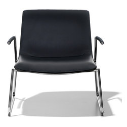De Sede - De Sede DS-717 Armchair - This lounge chair provides a peerless level of seating comfort despite the simplicity of its lines. Interior polyurethane shell with molded foam seat with dacron covering. Black lacquered polished outer shell; additional colors are available as an upgrade. Steel tubing construction in polished or matte chrome or, as an upgrade, can be coated in other colors. Transparent or black glides with optional felt or rubber inserts. Available in fabric or leather. SEDE-Click glides. Manufactured by de Sede in Switzerland. Price includes delivery to the USA.