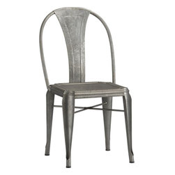 Lyle Side Chair - This dining room chair is all about the patina of the galvanized steel and the detail on the seat.