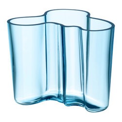 "iittala Aalto Light Blue Vase - 3-3/4"" - Sparkling like the sea, iittala's beautiful translucent Light Blue classic Aalto vase mimics the Finnish coastline in both color and in shape. An original hue for 2011, this color gives the vase a vintage look of antique glass."