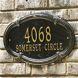 Ballard Designs - Somerset Oval Wall Address Sign - Antique gold lettering. Contrasting black background for high visibility. Acanthus scroll details. Our Somerset Oval Wall Address Sign has a classic look that will turn your address into the nicest one on the block. It's crafted of sand cast aluminum with weather-resistant paint to last the life of your home. For One-Line: Up to 5 numbers; for Two-Line: Up to 5 characters for top line and up to 16 characters for bottom line.Somerset Oval Wall Address Sign features: . . . *Please note that personalized items are non-returnable.