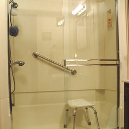 E\Z Step Bathtub to Walk in Shower Conversion - E|Z Step Notch Cut Tub to Walk in Shower Conversion and Upgraded Frameless Shower Enclosure - photo taken by Sherry Foose