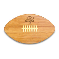 """Picnic Time - Tampa Bay Buccaneers Touchdown Pro Cutting Board in Natural Wood - The Touchdown! cutting board is a 15"""" x 8.75"""" x 0.75"""" board made of eco-friendly bamboo with a standard football design, with 123 square inches of cutting surface. It can be used as a cutting board or serving tray, or use both sides of the board, one for cutting and the other for serving. The backside of the board is solid dark bamboo. Go long...for the Touchdown! Decoration: Engraved"""
