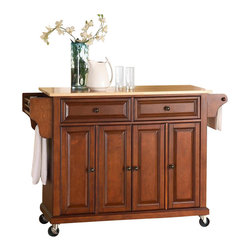 Crosley Furniture - Natural Wood Top Kitchen Cart/Island in Class - Beautiful Raised Panel Doors. Antique Brass Finish Hardware. Some assembly required. Total of Three Adjustable Shelves Inside Cabinet. Spice Rack with Towel Bar. Towel Bar / Paper Towel Holder. Solid Wood Top with Natural Finish. Solid Hardwood & Veneer Construction. 36 in. H x 52 in. W x 18 in. D (106.5 lbs.)Constructed of solid hardwood and wood veneers, this mobile kitchen cart is designed for longevity. The beautiful raised panel doors and drawer fronts provide the ultimate in style to dress up your kitchen. Two deep drawers are great for anything from utensils to storage containers. Behind the four doors, you will find adjustable shelves and an abundance of storage space for things that you prefer to be out of sight. The heavy duty casters provide the ultimate in mobility. When the cabinet is where you want it, simply engage the locking casters to prevent movement. Style, function, and quality make this mobile kitchen cart a wise addition to your home.