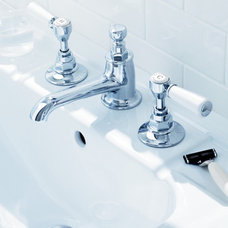 Traditional Bathroom Faucets And Showerheads by Cabochon Surfaces & Fixtures