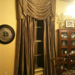 Panels - Formal Window treatment: Pinch pleated silk panels with blackout lining. Board-mounted swag and jabot valance with blackout lining
